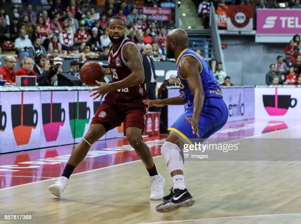 Reggie Redding of Bayern Muenchen and DeAndre Lansdowne of Braunschweig battle for the ball during the easyCredit BBL Basketball Bundesliga match...