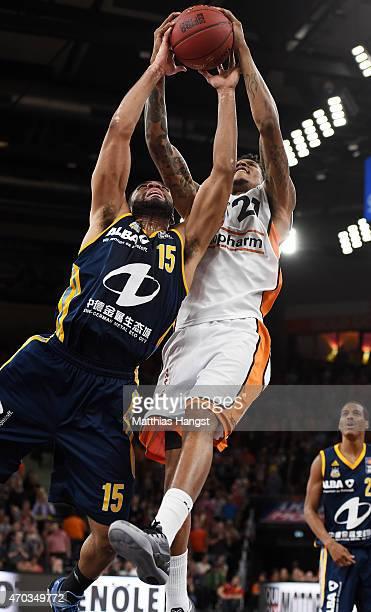 Reggie Redding of Berlin and Will Clyburn of Ulm go for a rebound during the Beko Basketball Bundesliga match between Ratiopharm Ulm and Alba Berlin...