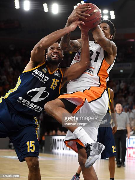 Reggie Redding of Berlin and Will Clyburn of Ulm go for a rebound during the Beko Basketball Bundesliga match between Ratiopharm Ulm and Alba Berlin...