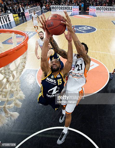 Reggie Redding of Berlin and Will Clyburn of Ulm jump for a rebound during the Beko Basketball Bundesliga match between Ratiopharm Ulm and Alba...