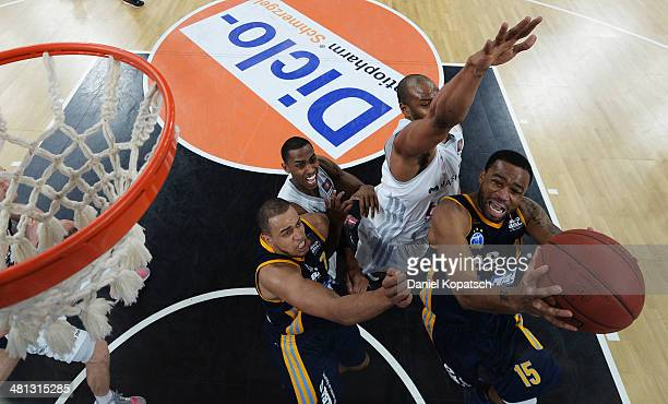 Reggie Redding of Berlin shoots during the Beko BBL Top Four semifinal match between Alba Berlin and Brose Baskets at ratiopharm arena on March 29...