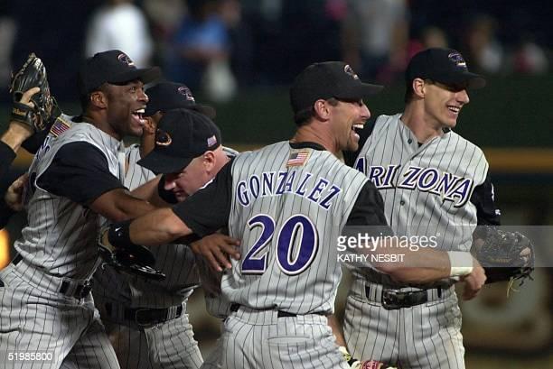Reggie Sanders Matt Williams Luis Gonzalez and series MVP Criag Counsell of the Arizona Diamondbacks celebrate after winning the National League...
