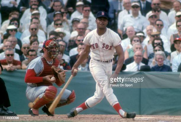 Reggie Smith of the Boston Red Sox swings at a pitch during a Major League Baseball game circa 1967 at Fenway Park in Boston Massachusetts Smith...