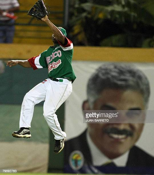 Reggie Taylor of Mexican Yaquis jumps to catch a ball during the Caribbean Series game against Dominican Republic Tigres de Licey at Cibao Stadium in...