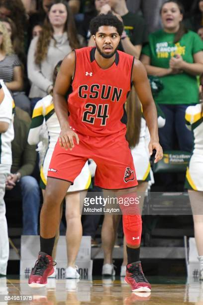 Reggie Theus Jr #24 of the Cal State Northridge Matadors looks on during a college basketball tournament against the George Mason Patriots at the...