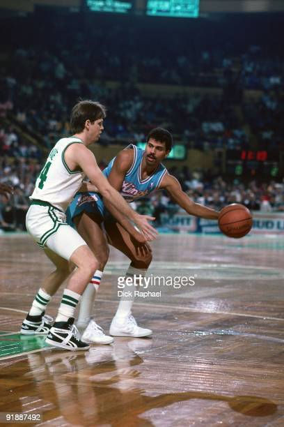 Reggie Theus of the Sacramento Kings looks to make a move against Danny Ainge of the Boston Celtics during a game played in 1987 at the Boston Garden...