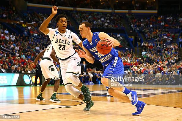 Reggie Upshaw of the Middle Tennessee Blue Raiders drives with the ball against Deyonta Davis of the Michigan State Spartans in the first half during...