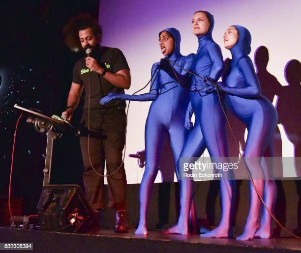 Reggie Watts and Cocoon Central Dance Team's Sunita Mani Eleanore Pienta and Tallie Medel perform onstage at the screening of 'Snowy Bing Bongs' at...