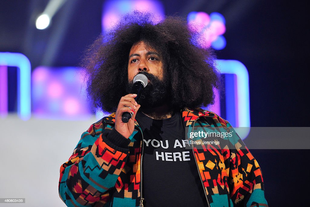 <a gi-track='captionPersonalityLinkClicked' href=/galleries/search?phrase=Reggie+Watts&family=editorial&specificpeople=2221425 ng-click='$event.stopPropagation()'>Reggie Watts</a> in Oakland, CA performs to 16,000 students and educators at the first We Day California at ORACLE Arena on March 26, 2014 in Oakland, California.