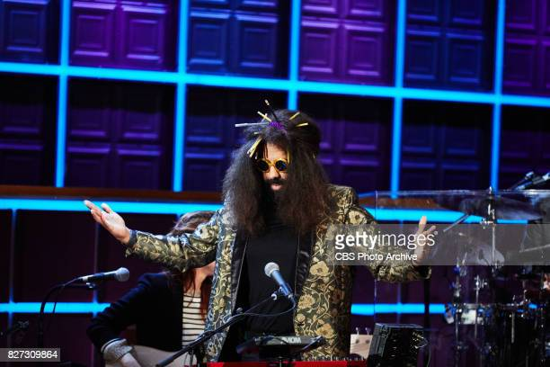 Reggie Watts inserts pencils into his hair during 'The Late Late Show with James Corden' Tuesday August 1 2017 On The CBS Television Network
