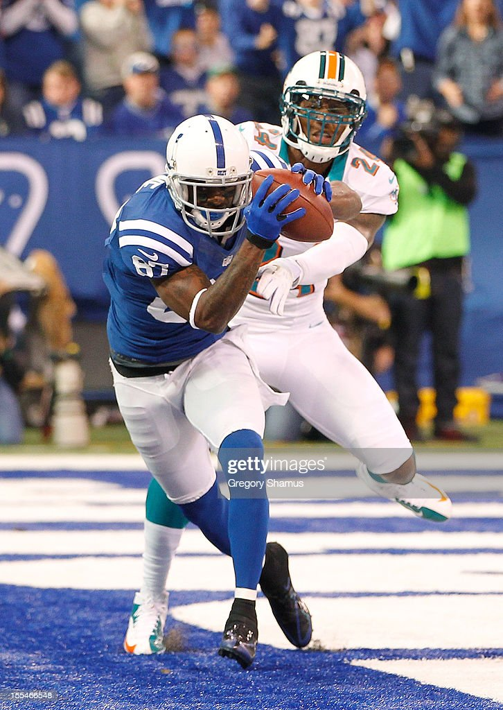 <a gi-track='captionPersonalityLinkClicked' href=/galleries/search?phrase=Reggie+Wayne&family=editorial&specificpeople=208684 ng-click='$event.stopPropagation()'>Reggie Wayne</a> #87 of the Indianapolis Colts catches a fist quarter touchdown in front of Sean Smith #24 of the Miami Dolphins at Lucas Oil Stadium on November 4, 2012 in Indianapolis, Indiana.