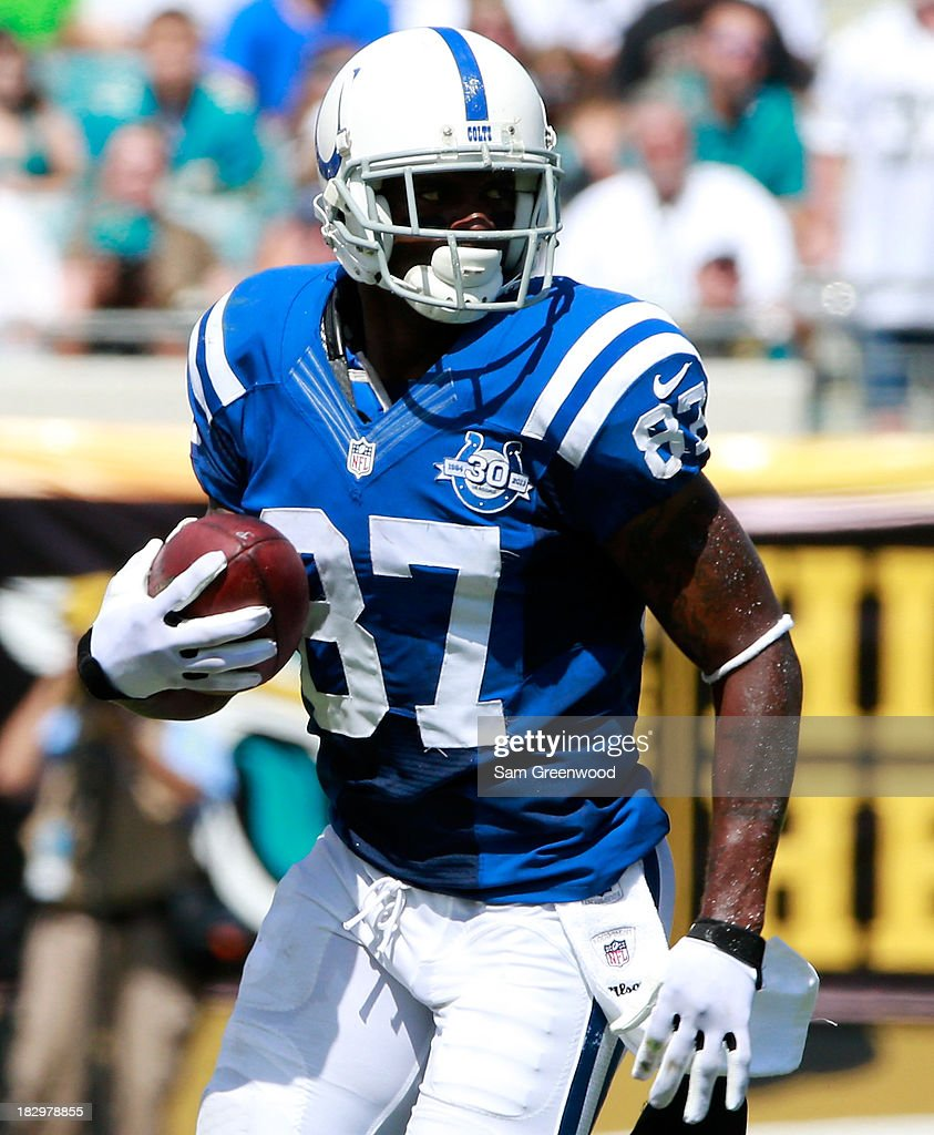 <a gi-track='captionPersonalityLinkClicked' href=/galleries/search?phrase=Reggie+Wayne&family=editorial&specificpeople=208684 ng-click='$event.stopPropagation()'>Reggie Wayne</a> #87 of the Indianapolis Colts runs for yardage during the game against the Jacksonville Jaguars at EverBank Field on September 29, 2013 in Jacksonville, Florida.