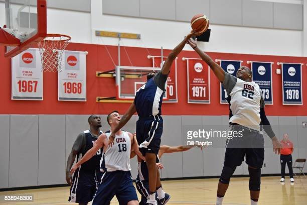 Reggie Williams and Jonathan Holmes of the USA AmeriCup Team go up for a rebound during a training camp at the University of Houston in Houston Texas...