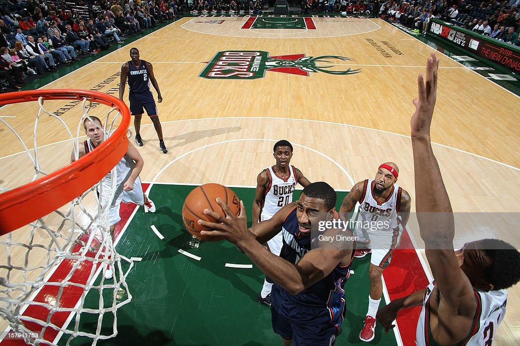Reggie Williams #55 of the Charlotte Bobcats goes to the basket against John Henson #31 of the Milwaukee Bucks during the game on December 7, 2012 at the BMO Harris Bradley Center in Milwaukee, Wisconsin.