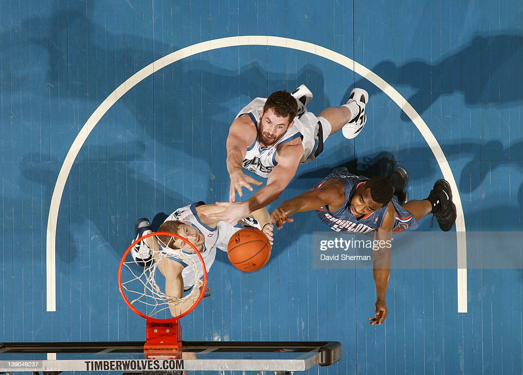 Reggie Williams #55 of the Charlotte Bobcats reaches for the ball against <a gi-track='captionPersonalityLinkClicked' href=/galleries/search?phrase=Luke+Ridnour&family=editorial&specificpeople=201824 ng-click='$event.stopPropagation()'>Luke Ridnour</a> #13 and <a gi-track='captionPersonalityLinkClicked' href=/galleries/search?phrase=Kevin+Love&family=editorial&specificpeople=4212726 ng-click='$event.stopPropagation()'>Kevin Love</a> #42 of the Minnesota Timberwolves during the game on February 15, 2012 at Target Center in Minneapolis, Minnesota.