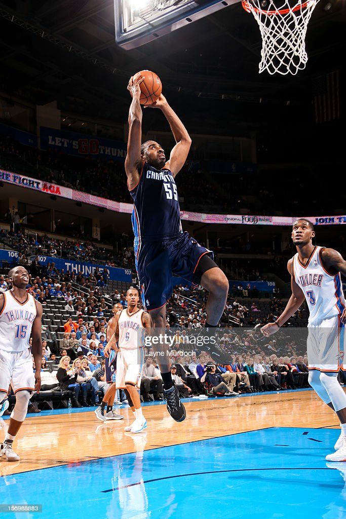 Reggie Williams #55 of the Charlotte Bobcats rises for a dunk against the Oklahoma City Thunder on November 26, 2012 at the Chesapeake Energy Arena in Oklahoma City, Oklahoma.