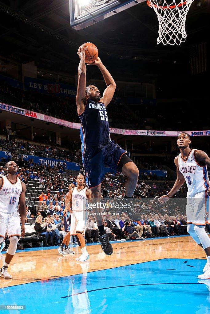 Reggie Williams #55 of the Charlotte Bobcats rises for a dunk against the Oklahoma City Thunder on November 26, 2012 at the Chesapeake Energy Arena in Oklahoma City, Oklahoma.