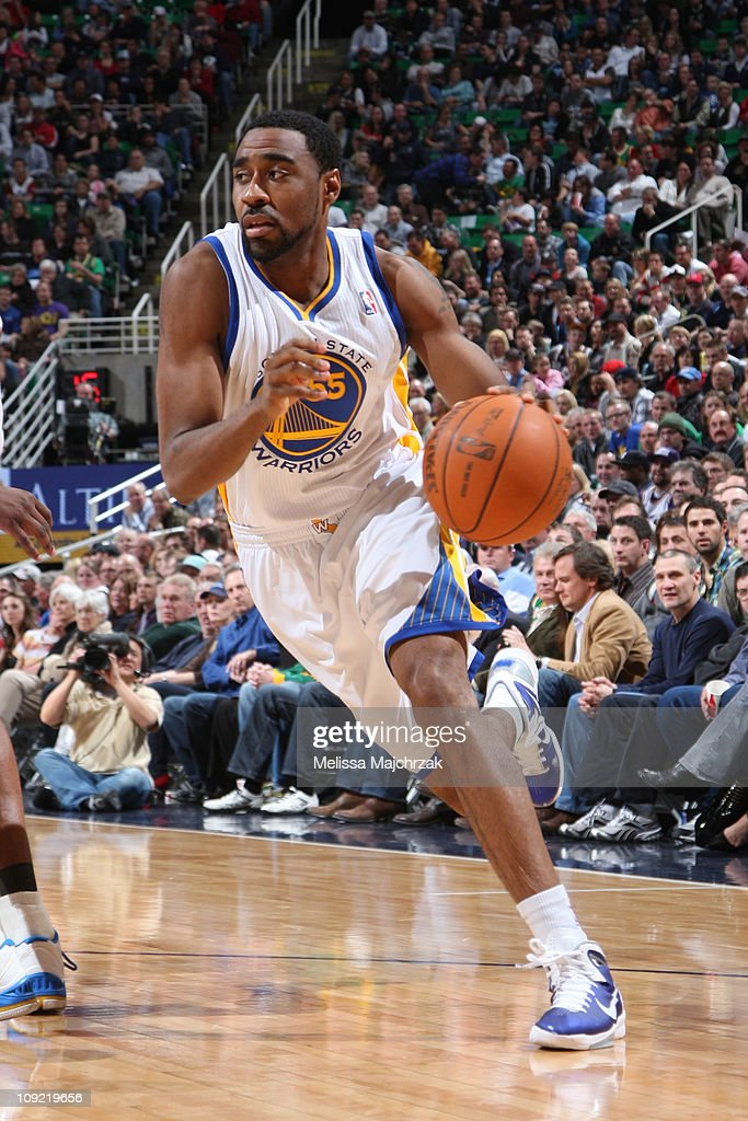 Reggie Williams #55 of the Golden State Warriors drives the ball against the defense of the Utah Jazz at EnergySolutions Arena on February 16, 2011 in Salt Lake City, Utah.