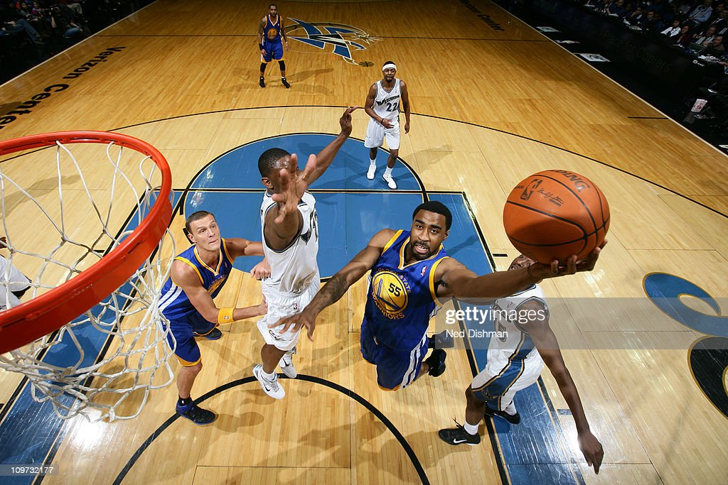 Reggie Williams #55 of the Golden State Warriors shoots against <a gi-track='captionPersonalityLinkClicked' href=/galleries/search?phrase=Kevin+Seraphin&family=editorial&specificpeople=6474998 ng-click='$event.stopPropagation()'>Kevin Seraphin</a> #13 of the Washington Wizards at the Verizon Center on March 2, 2011 in Washington, DC.