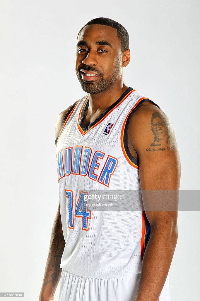 Reggie Williams #14 of the Oklahoma City Thunder poses for a portrait during a 2014 NBA shoot on March 10, 2014 at the Thunder Events Center in Edmond, Oklahoma.