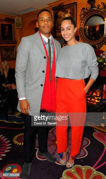 Reggie Yates and guest attend Veuve Clicquot Style Party at Annabel's on November 26 2013 in London England