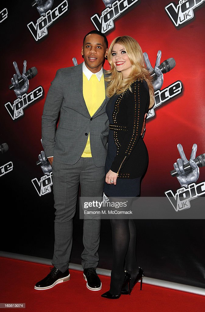Reggie Yates (L) and Holly Willoughby attends a photocall to launch the second series of The Voice at Soho Hotel on March 11, 2013 in London, England.