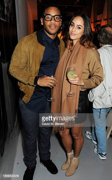 Reggie Yates and Tia Ward attend a private view of the 'Virgin Records 40 Years Of Disruptions' exhibition at Victoria House on October 23 2013 in...