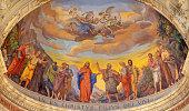 Reggio Emilia - The fresco of Jesus and the apostles in main apse of church Chiesa di San Pietro by Anselmo Govi (1939).