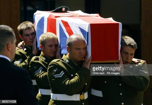 Regimental colleagues of Cpl John Johnston Cosby carry his coffin from Belmont Chapel in Exeter after his funeral