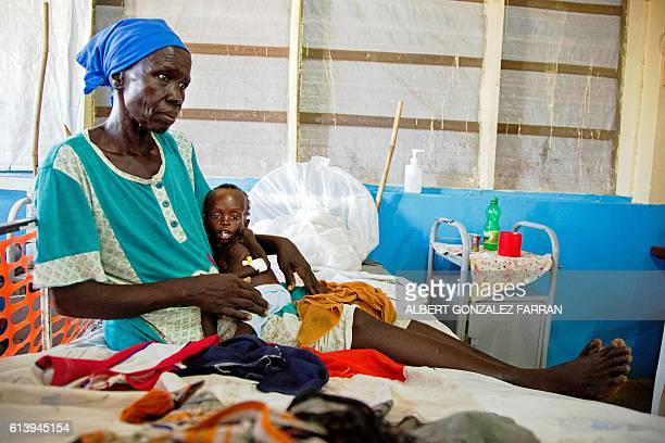 Regina Aluel holds her grandson Agop Manut 11monthsold who suffers acute malnutrition and respiratory distress at the clinic run by Doctors Without...