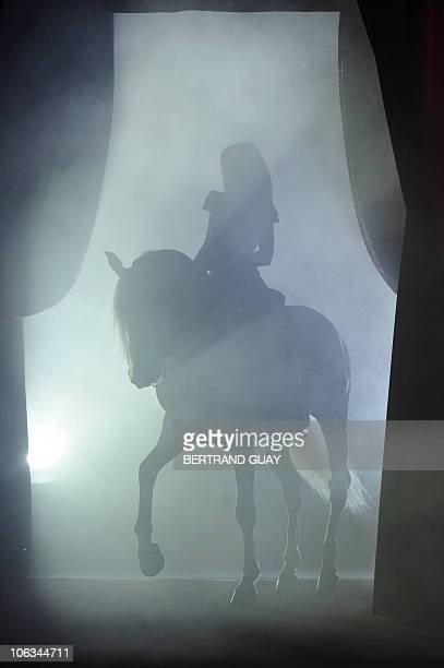 Regina Bouglione performs with her horse during the 'Prestige' Bouglione circus show at the Cirque d'Hiver in Paris on October 26 2010 AFP PHOTO /...