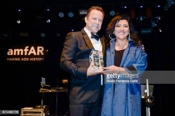 Regina Caze and Vik Muniz attends the 7th Annual amfAR Inspiration Gala on April 27 2017 in Sao Paulo Brazil