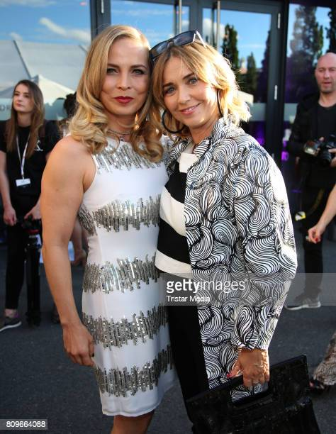 Regina Halmich and Tina Ruland attend the Guido Maria Kretschmer Fashion Show Autumn/Winter 2017 at Tempodrom on July 5 2017 in Berlin Germany