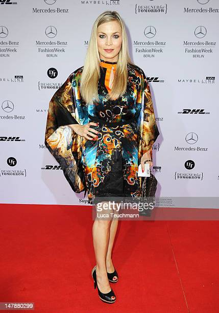 Regina Halmich arrives for the UnrathStrano Red Carpet at the MercedesBenz Fashion Week Spring/Summer 2013 on July 5 2012 in Berlin Germany
