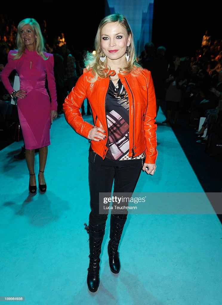 Regina Halmich attends Blacky Dress Autumn/Winter 2013/14 fashion show during Mercedes-Benz Fashion Week Berlin at Brandenburg Gate on January 16, 2013 in Berlin, Germany.