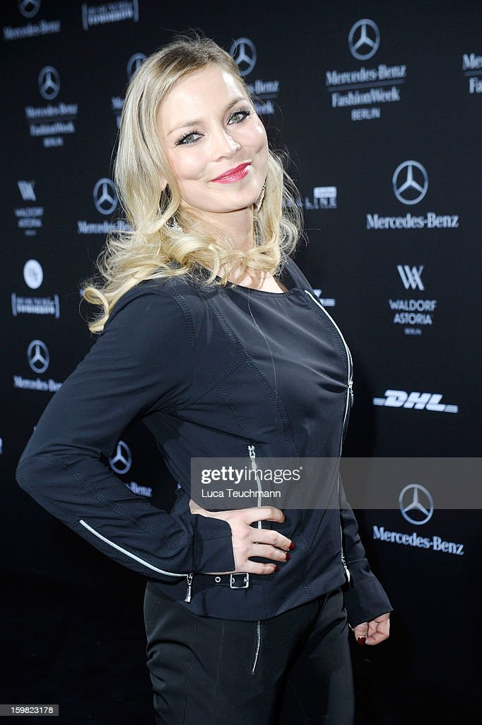Regina Halmich attends Minx By Eva Lutz Autumn/Winter 2013/14 fashion show during Mercedes-Benz Fashion Week Berlin at Brandenburg Gate on January 16, 2013 in Berlin, Germany.