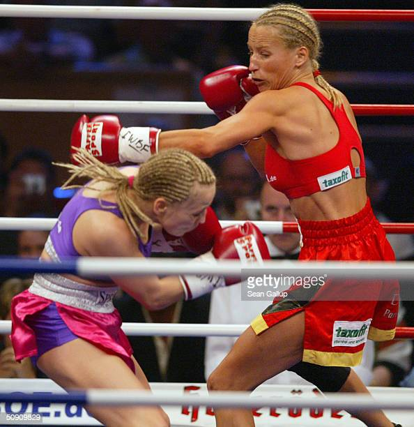 Regina Halmich dodges a swing from Daisy Lang in their 10round match in the IWBF Junior Bantam Women's World Boxing Championship Match on May 29 2004...