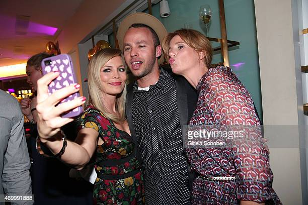 Regina Halmich Marlon Roudette Mareile Hoeppner during the 50th Anniversary of AIGNER on April 16 2015 in Munich Germany