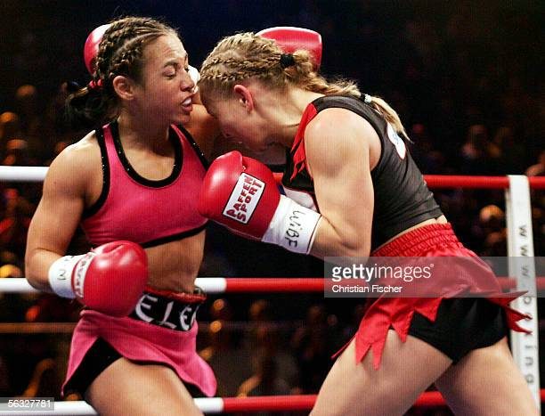 Regina Halmich of Germany hits Elena Reid of US during the Women's WIBF Flyweight Championship on December 3 2005 at the Boerderlandhalle in...