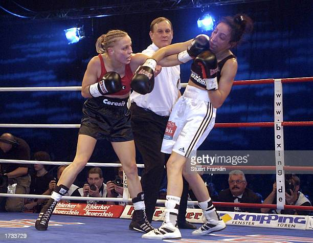 Regina Halmich of Karlsruhe and Nadja Loritz of Koblenz in action during the WIBF fly weight World title fight at The Grugahalle Essen Germany on...