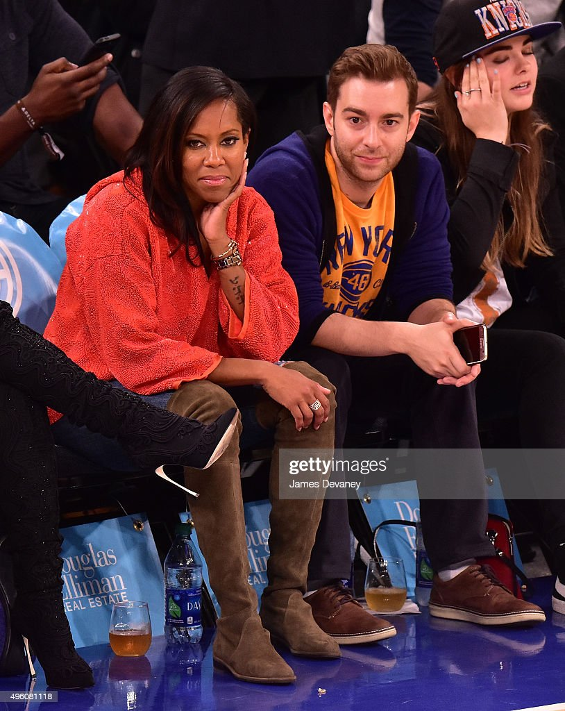 Regina King and guest attend New York Knicks vs Milwaukee Bucks game at Madison Square Garden on November 6, 2015 in New York City.