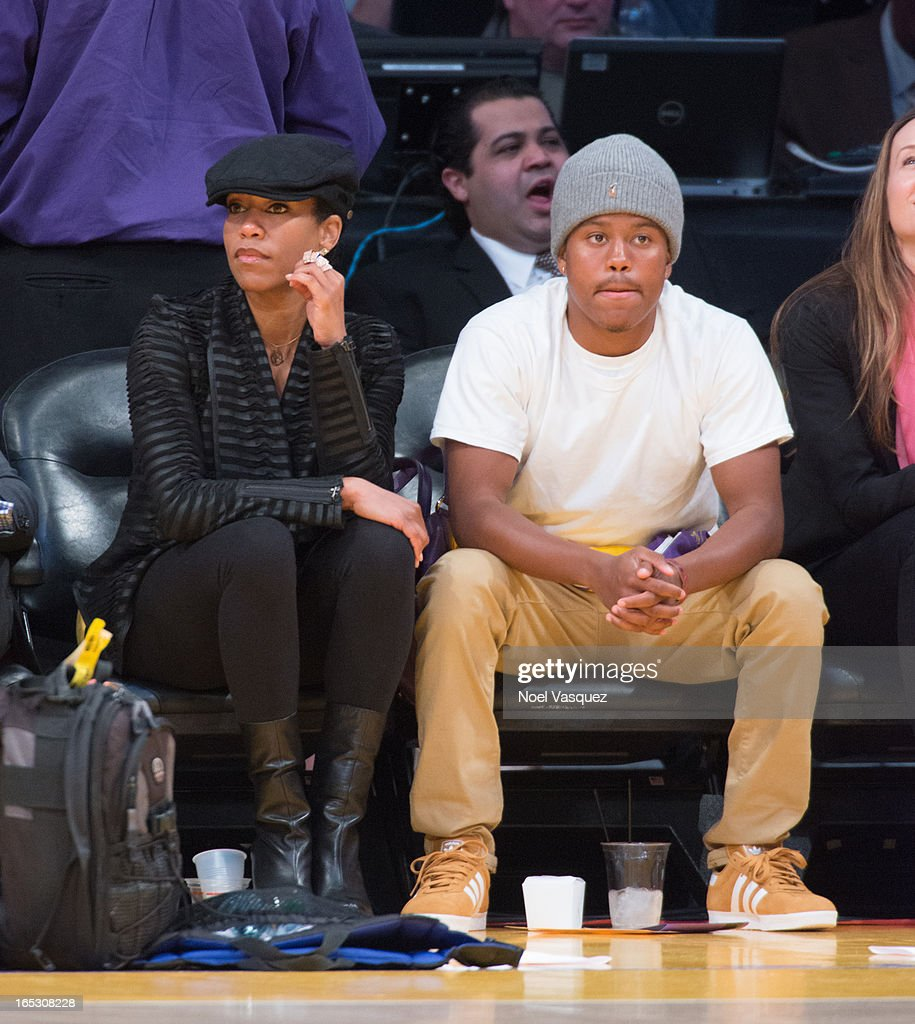 Regina King (L) and her son Ian attend a basketball game between the Dallas Mavericks and the Los Angeles Lakers at Staples Center on April 2, 2013 in Los Angeles, California.