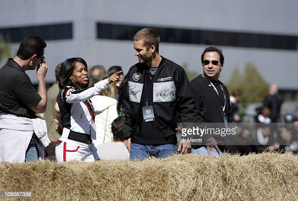 Regina King and Paul Walker during 3rd Annual Cadillac Super Bowl Grand Prix for Charity at CSX in Jacksonville Florida United States