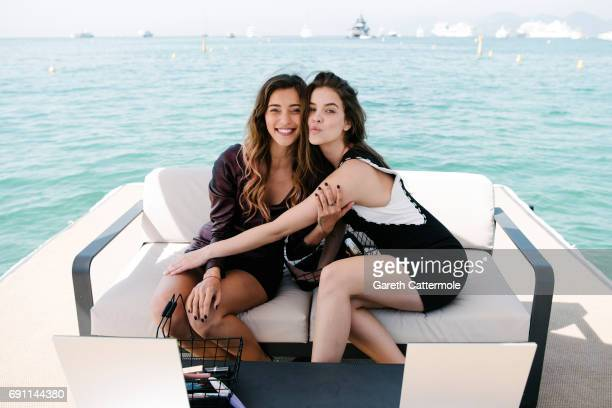 Regina Todorenko and Barbara Palvin are photographed at the L'Oreal Paris Beach during the 70th annual Cannes Film Festival on May 24 2017 in Cannes...
