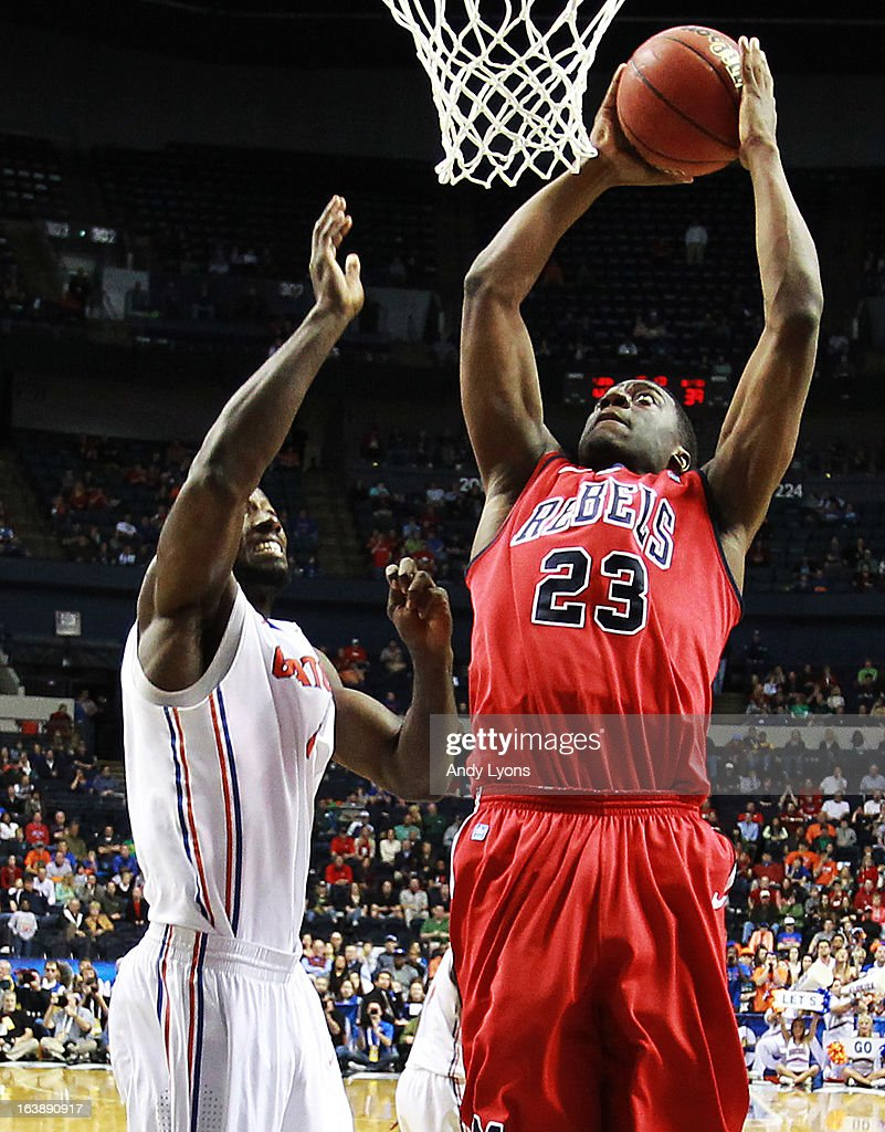 Reginald Buckner #23 of the Ole Miss Rebels goes up against Kenny Boynton #1 of the Florida Gators in the second half of the SEC Basketball Tournament Championship game at Bridgestone Arena on March 17, 2013 in Nashville, Tennessee.