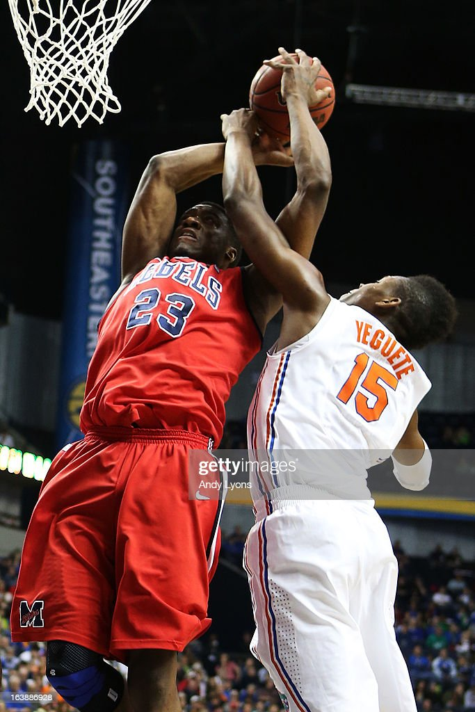 Reginald Buckner #23 of the Ole Miss Rebels goes up against Will Yeguete #15 of the Florida Gators in the first half during the SEC Basketball Tournament Championship game at Bridgestone Arena on March 17, 2013 in Nashville, Tennessee.