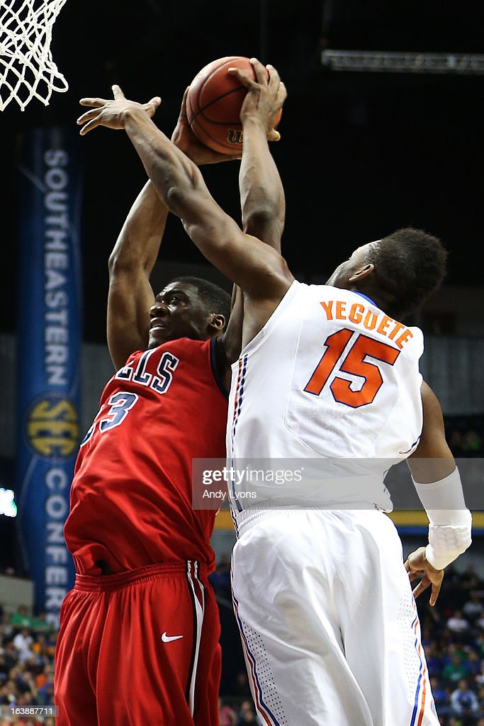Reginald Buckner #23 of the Ole Miss Rebels goes up against Will Yeguete #15 of the Florida Gators in the first half of the SEC Basketball Tournament Championship game at Bridgestone Arena on March 17, 2013 in Nashville, Tennessee.