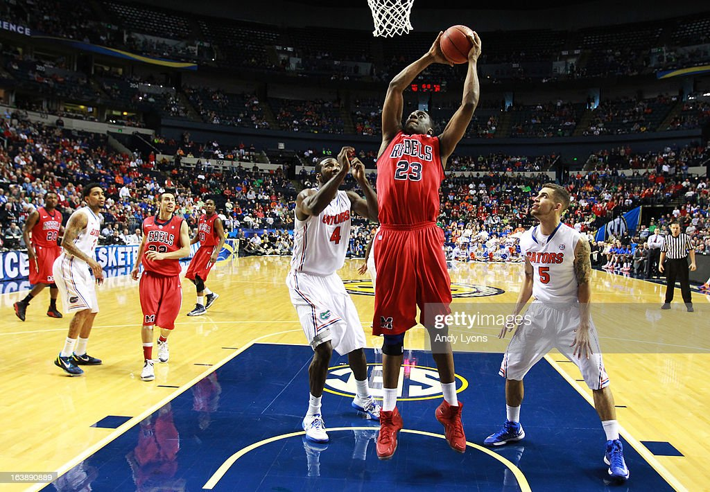 Reginald Buckner #23 of the Ole Miss Rebels goes up between Patric Young #4 and Scottie Wilbekin #5 of the Florida Gators in the second half of the SEC Basketball Tournament Championship game at Bridgestone Arena on March 17, 2013 in Nashville, Tennessee.