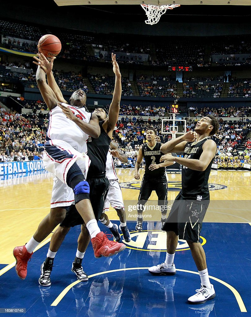 Reginald Buckner #23 of the Ole Miss Rebels looks to shoot against Kevin Bright #15 of the Vanderbilt Commodores in the second half during the Semifinals of the SEC basketball tournament at Bridgestone Arena on March 16, 2013 in Nashville, Tennessee.