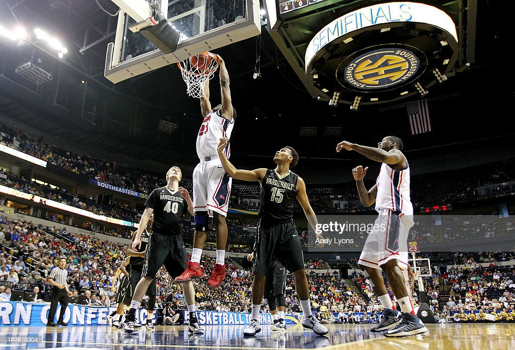 Reginald Buckner #23 of the Ole Miss Rebels shoots against <a gi-track='captionPersonalityLinkClicked' href=/galleries/search?phrase=Josh+Henderson+-+Basketball+Player&family=editorial&specificpeople=15212566 ng-click='$event.stopPropagation()'>Josh Henderson</a> #40 and Kevin Bright #15 of the Vanderbilt Commodores in the second half during the Semifinals of the SEC basketball tournament at Bridgestone Arena on March 16, 2013 in Nashville, Tennessee. Ole Miss won 64-52.
